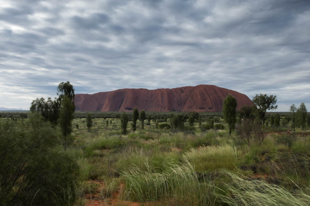 Driving past Uluru on our outback roadtrip.