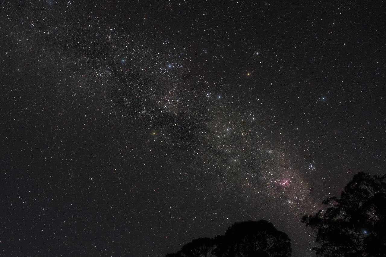 Watching the milky way while hiking the overland track